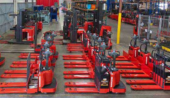 Used pallet jacks and lift trucks in a warehouse setting