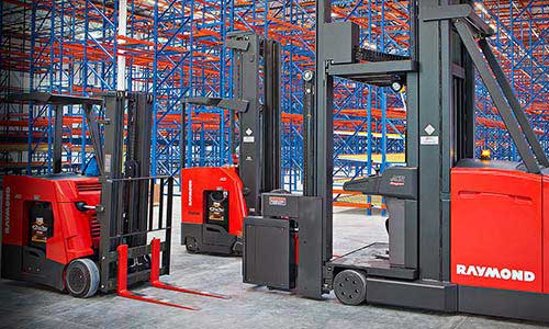 Three rental forklifts from Pengate parked in warehouse