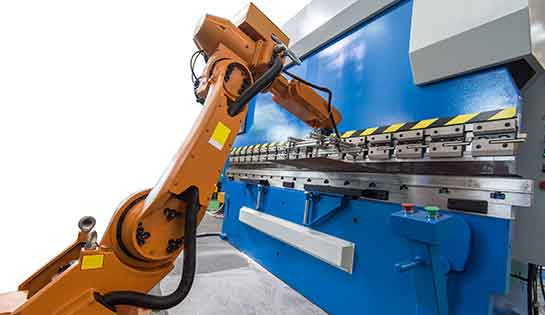 Automated industrial robot working in warehouse setting