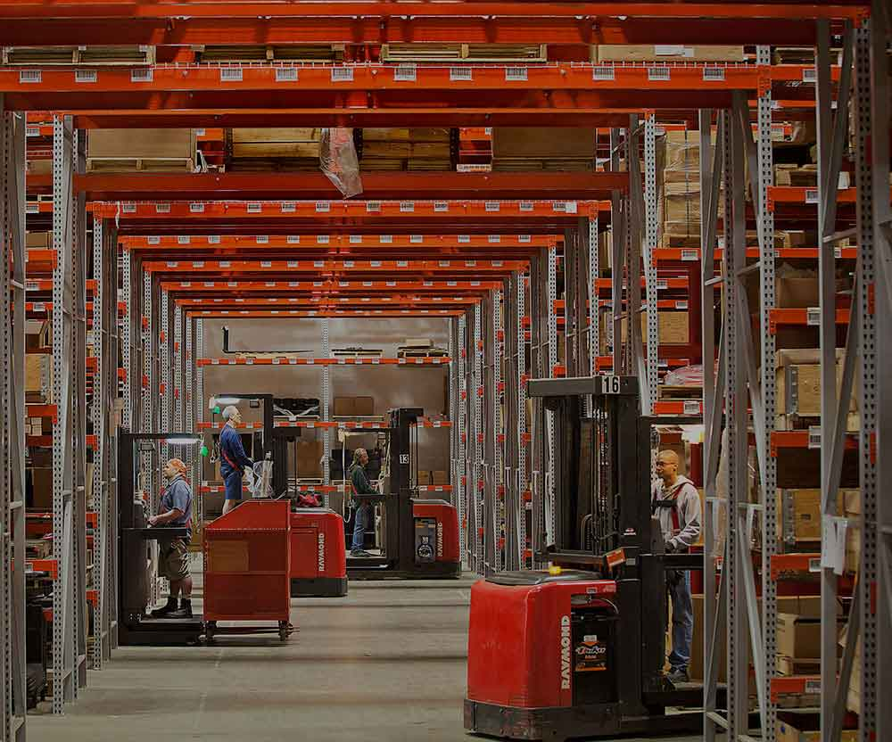Forklift operators on Raymond lift trucks in an eCommerce warehousing setting