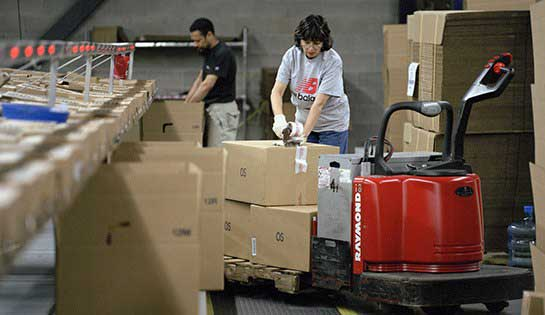 Warehouse laborers complete tasks in optimized warehouse setting