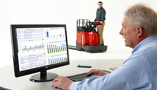 Warehouse manager reviews reports from iWAREHOUSE warehouse optimization consulting software on desktop