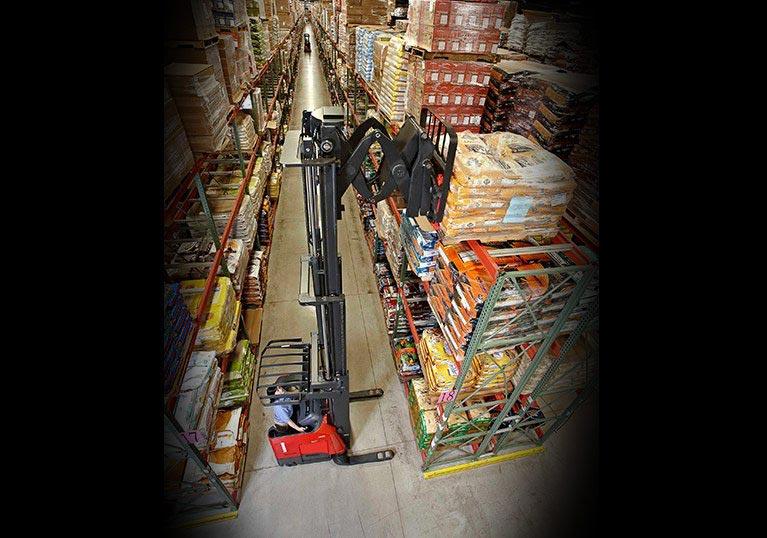 Raymond deep reach forklift in narrow aisle warehouse